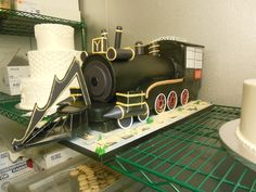 """A surprise groomscake for a wedding - We created the time traveling train from """"Back To The Future III""""."""