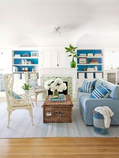 Wooden floors, a light blue and white colour scheme and a wicker basket/coffee table :)