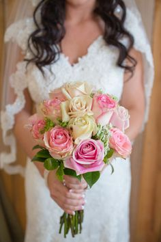 The bride carries a #bouquet of Queen Anne's lace and pink and ivory roses embellished with pearl pins. {@jamieblow}
