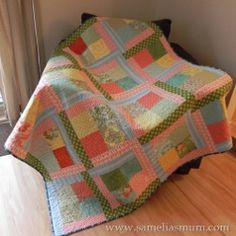 Scrappy Flora Throw   FaveQuilts.com