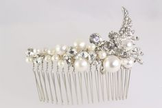 Handmade in Finland with rhinestones and freshwater pearls.