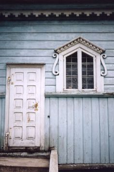 Eastern Europe white doors on blue wooden wal