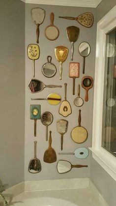 Love this - hand mirrors, but some turned so the back shows.