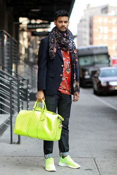 Mathieu Lebreton wears the Chapman Brothers for Louis Vuitton (F/W 13-14) T-shirt and scarf and carries a S/S 13 Damier Infini fluo Keepall (Photo by Temoc via http://daaamn.com/)