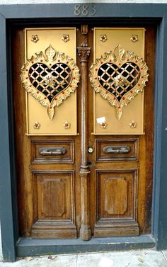 Fancy doors, not just the hearts, but the overall wood look - don't know where this is