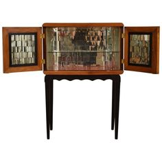 Unusual Italian Mirrored Glass 1940s Bar Cabinet | From a unique collection of antique and modern dry bars at https://www.1stdibs.com/furniture/storage-case-pieces/dry-bars/