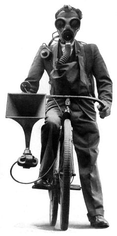 Masked Cyclist Sounds Gas-Attack Warning (1936)  -- Sounding a loud alarm through a loudspeaker clamped to the handlebars of his bicycle, a masked rider wheeled through London streets recently, like a modern Paul Revere, to test the efficiency of a new method of warning the public against sudden aerial gas attacks in war time. Equipped with gas mask and respirator, the cyclist broadcast warnings through a microphone built into the mask and wired to the battery-operated loudspeaker.