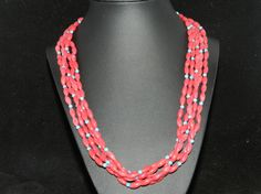 Check out this item in my Etsy shop https://www.etsy.com/listing/278029032/ft756-four-strand-red-coral-necklace