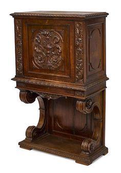 A Renaissance style carved walnut side cupboard circa 1900