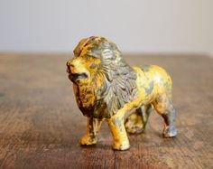 Vintage Lion Bank  Cast Iron Still Bank by TheFancyLamb on Etsy, $92.00