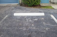 Before and After Pictures from a CarStop Job at Smith Street Industrial for a property manager of CSG. #CarStops #ParkingLotMaintenance  #BeforeandAfter