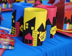 Superheroes Theme - Turn old cans or jars into mini cityscapes and use them for centerpieces. Superman Party, Girl Superhero Party, Superhero Baby Shower, Spider Man Party, Avenger Party, Avengers Birthday, Batman Birthday, Anniversaire Wonder Woman, Festa Pj Masks