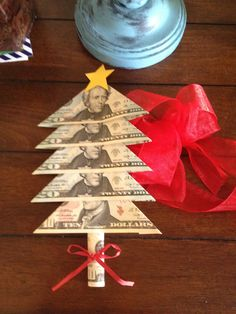 DIY Money Tree. (I got the inspiration from Pinterest, but made my own design).   Fold bills; dab small amount of glue stick to hold in place. Roll final bill to create tree trunk.  Add star and ribbon. My son loved it!