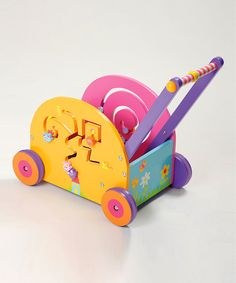 This push and play wagon fills a little one's world with wonder! A maze on both sides will engage their curiosity, and the large box will encourage walking as kids collect toys and push them around the house.20.9'' W x 18.1'' H x 11.4'' DWoodRecommended for ages 12 months and upImport...