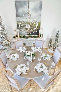 Neutral Rustic Glam Christmas Dining Room. #rusticglam #rusticdecor #christmastable #neutralchristmas #rusticchic #coastalliving #diningroom