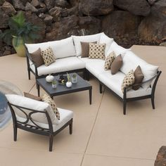 Very pretty! I like the look of this - sectional but also wrought iron look too. RST Brands Outdoor Astoria 6 Piece Seating Group with Cushion & Reviews | Wayfair