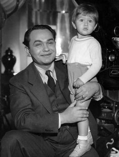 Edward G. Robinson and Junior   My Grandfather could pass for Edward's twin brother  If you were to see the photo i have.