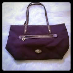 Coach Maroon Tote Brand new with tags, never used. Zipper on outside and inside. Lavender inside lining Coach Bags Shoulder Bags