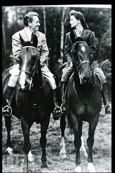 Hepburn & Tracy on horseback.