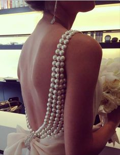 Pearls on a drop back dress. This is everything. Complete perfection. Absolutely beautiful..