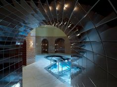 St. Pancras Renaissance Hotel, London, England - In the basement of the St. Pancras railway station's historic, recently renovated hotel, there is a spa centered on a dramatically tiled pool perked up with whirlpool bubbles.