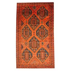 With a distinctive style, a gorgeous area rug from Afghanistan will add some splendor to any decor. This Tribal Balouchi area rug is hand-knotted with a geometric pattern in shades of rust, navy, orange, ivory, beige, brown, gold, and red.