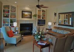 Install wall candle sconces in a family room & create a cozy haven. Use large wall sconces & go bigger w/ the candles