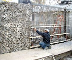 concrete and cinder block debris filled gabion wall Gabion Stone, Gabion Fence, Gabion Wall, Stone Fence, Concrete Fence, Fence Design, Garden Design, Wall Design, Garden Screening