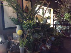 Wagon wheel with green #roograyson #wagon #wheel #green #flowers #florist #homedecor #home #decor #design