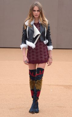 Cara Delevingne from Stars at London Fashion Week Fall 2015  Does she ever disappoint? The bold model makes her way to the Burberry Prorsum show in an oxblood lac mini and eye-catching boots.