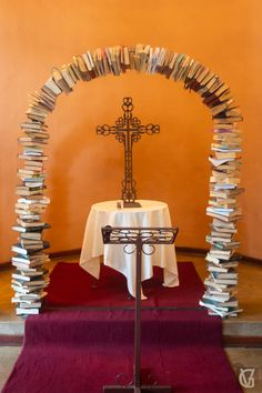 A wedding arch made of books at the chapel