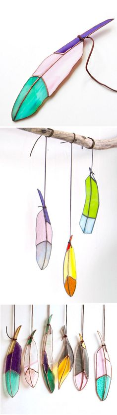These beautiful handcrafted stained glass feathers by Colin Adrian can be displayed in a variety of imaginative ways.