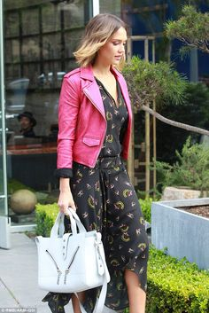 Pink is pretty: Jessica Alba attracted gazes during a furniture shopping spree in LA on Thursday thanks to that pink leather jacket