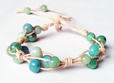 Natural hemp knotted bracelet with a mix of green and blue faux stone beads. £3.50, via Etsy.