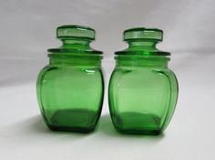 Apothecary Jars..   https://www.etsy.com/listing/251751408/vintage-apothecary-jars-green-glass