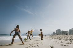 Childrens playing footbal in Ipanema beach, Brazil during the worldcup.