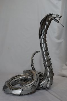 Sculptures entirely made from car hubcaps/wheel trims collected from the side of the road. - Imgur TALENT Upcycle Car Parts - Reuse Recycle Repurpose DIY DIY using parts from Cars, Motorcycles, Trucks, and more. -- Pin shared by Automotive Service Garage in Sarasota, FL -https://www.facebook.com/AUTOREPAIRSARASOTA