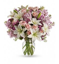 Light pink spray roses, fragrant white lilies and other favorites in a sparkling glass vase - they'll be floating on air all week. see more at sendflowersandmore.com