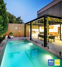 Combining a modern outdoor living space with a refurbished in ground concrete swimming pool.
