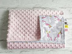 Modern, stylish and cute.  Handmade baby blanket in unocorn patterned cotton and minky plush in baby pink.  >>>>>-------> INFO <----------<<<<<  This is a modern and very popular blanket made of 2 layers. One is 100% cotton and the other is minky plush. This stylish blanket is handmade with extra care, with some matching decorative tags on a side (optional).   >>>>>------> SIZE <-------<<<<<<  It measures 100cm x 75cm ...