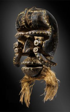 Africa | Old mask from the Kran people of Liberia | Wood, brass / copper nails, metal and natural fiber | ca. 1976 or earlier