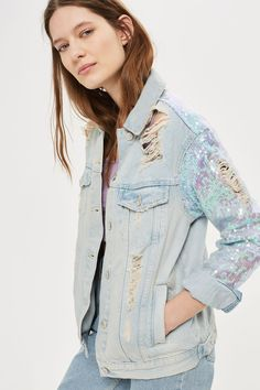 The denim jacket gets an after-dark update with this super-cool style. In a bleach stone wash it comes with statement sequin sleeves and distressed detail for an edgy finish.