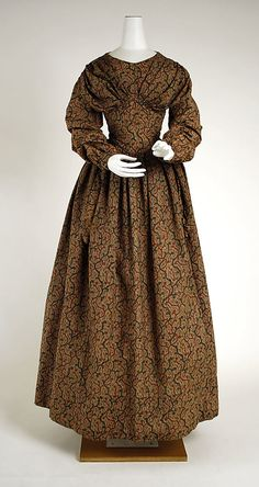 Dress  Date: 1838–40 Culture: American Medium: cotton, wool Dimensions: [no dimensions available] Credit Line: Gift of Mrs. Aline Bernstein, 1938 Accession Number: C.I.38.100.2