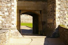 """The King's Gate, Inner Curtain Wall, Dover Castle, Kent, England, UK. Northern entrance into the Inner Bailey, or Keep Yard, with the base of the Keep (""""Great Tower"""") visible through the gateway arch. Vaulted passage with drawbridge and portcullis and flanked by 2 of the inner wall's 14 towers. Photo taken from the King's Gate Barbican. Norman Listed Building, English Heritage, and Scheduled Ancient Monument. Medieval History, Travel, and Tourism. See: http://www.panoramio.com/photo/87528085"""