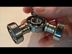How to make a Fidget Spinner or Hand Spinner from some old stuff in the garage. You don´t need a hacksaw to get the bearings out try to push them out instead...