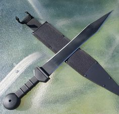 The Cold Steel Gladius Machete was derived from the sword used by Celtic tribes of ancient Iberia (Spain) and adopted by the Roman Legions, the Gladius, with its long, narrow point and wasp waisted blade, was the scourge of the battlefield and often the last thing seen or felt by Rome's enemies. Read more... http://www.osograndeknives.com/store/catalog/machetes/cold-steel-97gms-gladius-machete-includes-sheath-395.html