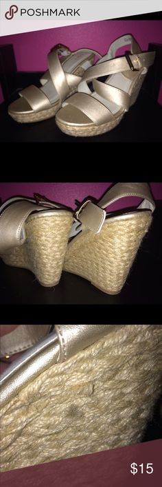 Gold wedges Gold size 7 wedges from Cato fashions. Worn once for a wedding. Does have tiny little frays sticking out on the wedge part but not very noticeable. Adjustable buckle for loosening and tightening. catos Shoes Wedges