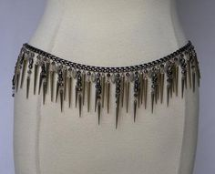A Rocker style or festive spikes as icicles chain belt, a black waist or hip chain loaded with charms. #Belt #Unique #Fun