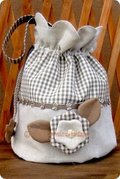 brown & white fabric bag with large flower