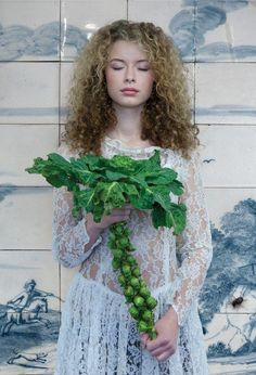 girl with Brussels sprouts Photo by saskia wagenvoort — National Geographic Your Shot